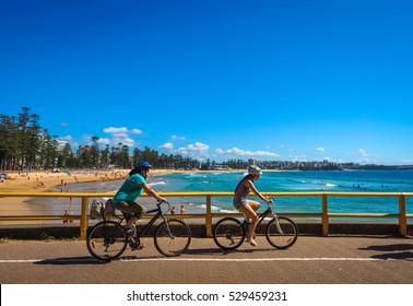 SYDNEY - Mar 5, 2016: People ride a bike along Manly Scenic Walkway in Sydney, Australia.