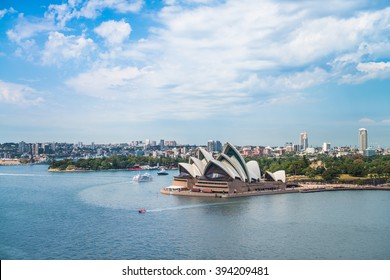 SYDNEY - MARCH 14: View of the iconic Sydney Opera House from the Harbour Bridge by daylight with ships passing by on March 14, 2016 in Sydney, Australia.