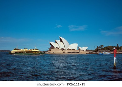 Sydney; March 2020: Sydney Harbour Ferry passing by the Opera house, heading to the wharf, public transport in Sydney, Australia.
