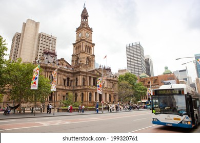 SYDNEY - MARCH 22: View of Sydney Town Hall and city's CBD building in the background on March 22, 2011 in Sydney, Australia. Built in the 1880s,the Town Hall is a landmark building of Sydney.