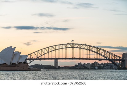SYDNEY - MARCH 24: View of the iconic Sydney Opera House and the Sydney Harbour Bridge at sunset from Mrs. Macquarie's Chair on March 24, 2016 in Sydney, Australia.