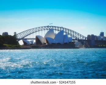 SYDNEY - March 4, 2016: Opera House View with Harbour Bridge in Sunny Day, Famous Landmark in Sydney, Australia.