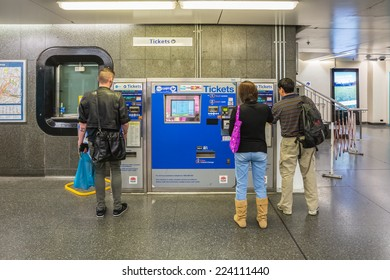 SYDNEY - MAY 16: Passengers buy ticket from vending machine in King Cross train station on May 16, 2014 in Sydney. The station is on the Eastern Suburbs line, one of the Sydney underground railways.