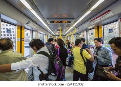 SYDNEY - MAY 16: Passengers in Light Rail on May 16, 2014 in Sydney. Sydney Trains is owned by the Government of New South Wales and operates all passenger rail services in metropolitan Sydney.