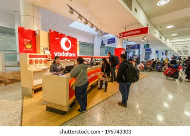SYDNEY- MAY 5 : Vodafone Mobile booths at Sydney (Kingsford Smith) Airport, Sydney, Australia on May 5, 14. It is the only major airport serving Sydney, and is a primary hub for Qantas.