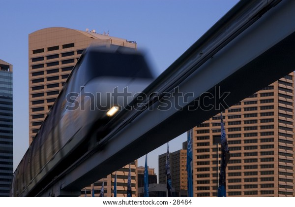 Sydney Monorail in the evening, against the towers of the CBD.