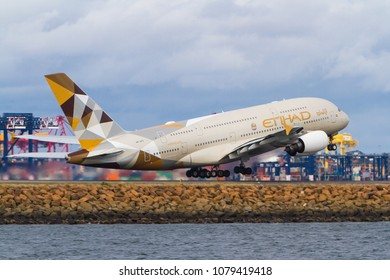 Sydney, New South Wales / Australia - April 29 2018: Etihad Airbus A380 airliner taking off from Sydney, Australia.