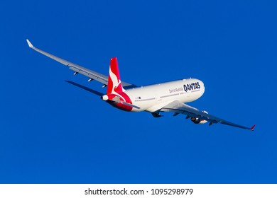 Sydney, New South Wales / Australia - May 20 2018: Qantas Airlines Airbus A330 Airliner in flight against blue skies over Sydney, Australia.