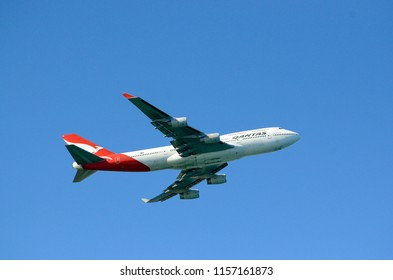 Sydney, New South Wales, Australia. July 2018. A Qantas jet takes off from Sydney's Kinsford-Smith Airport.