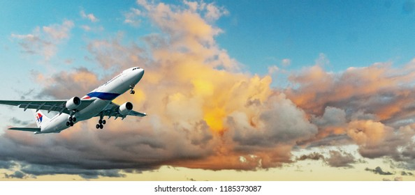 Sydney, New South Wales, Australia - August 16. 2014: Commercial passenger jet aircraft departing Sydney. Near sunset in yellow and grey coloured Cumulonimbus cloud on a blue sky.