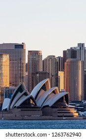 Sydney, New South Wales / Australia; August 12, 2018: DSydney Opera House and the skyline at sunset New South Wales, Australia
