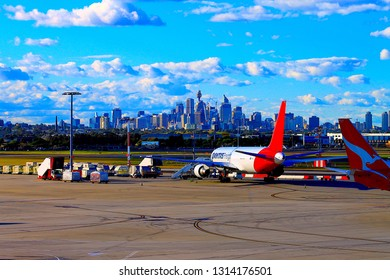 Sydney, New South Wales / Australia - July 02-2012: View from Kingsford Smith International Airport at a Qantas plane with the Sydney city scape in the background. Qantas is a well know airline.