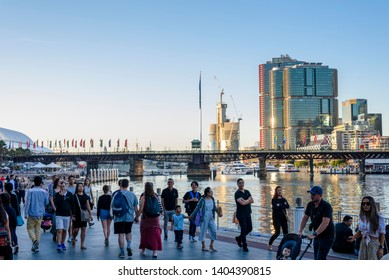 Sydney, New South Wales, Australia- 20 April 2019: People walking at Sydney Darling Harbour in a beautiful afternoon.