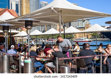 Sydney, New South Wales, Australia- 21 April 2019: People eating breakfast at Portobello Caffe at Circular Quay.