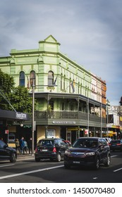 Sydney, New South Wales, Australia - JUNE 23rd, 2018: Weekend traffic driving past the Newtown Hotel on King Street.