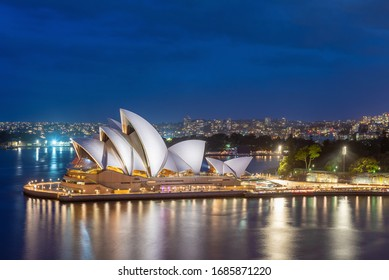 Sydney, New South Wales, Australia, 13 March, 2020 ; The Sydney Opera House and skyline illuminated at night.