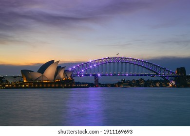 Sydney, New South Wales, Australia - May 5, 2019  A long exposure photo of the Opera House and bridge just after sunset at the harbor.