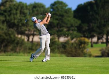 SYDNEY - NOV 11: American golfer Dustin Johnson plays a fairway shot at the Emirates Australian Open at The Lakes golf course. Sydney, November 11, 2011