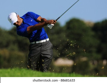 SYDNEY - NOV 11: - American golfer Tiger Woods plays from the rough in the third round at the Emirates Australian Open at The Lakes golf course. Sydney - November 11, 2011
