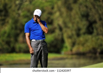 SYDNEY - NOV 12: American Tiger Woods anguish at his shot in the third round in the Australian Open at The Lakes golf course. Sydney