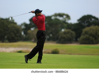 SYDNEY - NOV 13: American golfer Tiger Woods plays a iron from the 17th fairway in his fourth round at the Emirates Australian Open at The Lakes golf course. Sydney - November 13, 2011