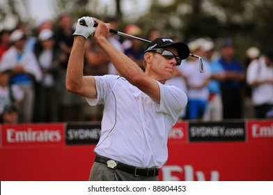 SYDNEY - NOV 13: Nick O'Hern tees off on the 18th in front of a large crowd at the Emirates Australian Open at The Lakes golf course. Sydney - November 13, 2011