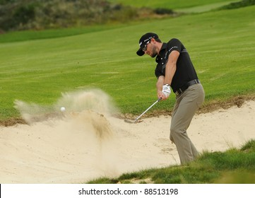 SYDNEY - NOVEMBER 10:. Kyle Stanley plays a bunker shot in the first round in the Australian Open at The Lakes golf course on November 10, 2011 in Sydney, Australia.