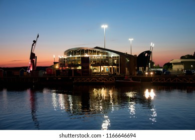 Sydney, NS, Canada - July 30, 2018:  The Joan Harriss Cruise Pavilion, the Flavor on the Water restaurant, and the world's largest fiddle, a monument to the Celtic heritage of Cape Breton.