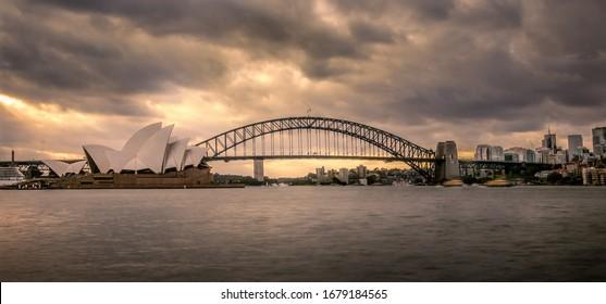 Sydney / NSW / Australia / 03 22 2020: Sydney Opera House and the Harbour Bridge at golden hour