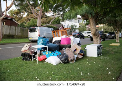 Sydney, NSW / Australia - April 3rd 2020 - a large pile of junk and used furniture heaped out on the side of the street for pick-up