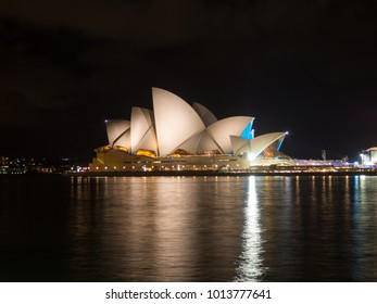Sydney, NSW / Australia - Dec 04 2017 -Sydney Opera House at night with black sky and water reflections. Sydney Opera House is a Modern Building, Well Known Worldwide.