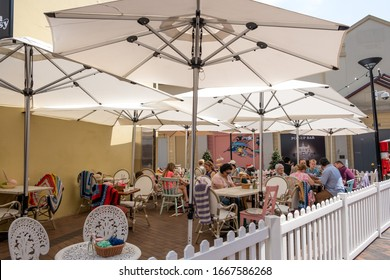 Sydney, NSW Australia - December 07 2019: Tourists rest and eat at chic cafe at the popular street market near The Rocks landmark.