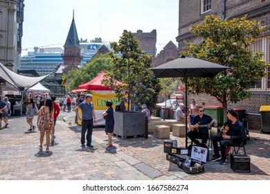 Sydney, NSW Australia - December 07 2019: Tourists patronise the popular street market near The Rocks landmark.