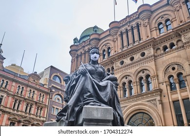 Sydney, NSW / Australia - Feb 22 2020: Exterior of Queen Victoria Building with Queen Victoria Statue wearing a mask because of Coronavirus COVID-19