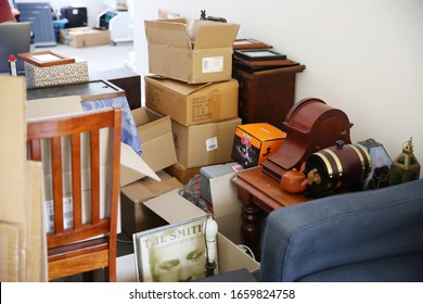 Sydney, NSW / Australia - Jan 27 2020 - a disorganised apartment full of moving boxes and household objects