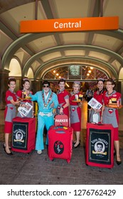 Sydney, NSW, Australia - January 10, 2018: Mayor Ken Keith of Parkes welcomes a group of Elvis fans at Central station to board a train to The Parkes Elvis Festival.