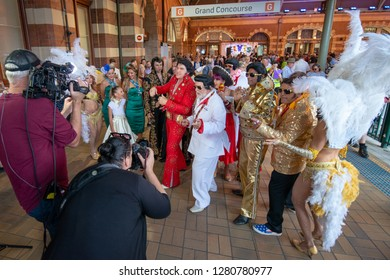 Sydney, NSW, Australia - January 10, 2019: Mayor Cr Ken Keith OAM, surrounded by Elvis Fans, conducting an interview before boarding the Elvis Express Train heading for the annual Elvis Festival at Pa