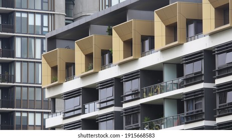Sydney, NSW  Australia - January 26 2021: The number of Sydney suburbs where high-rise apartments dwarf the number of homes is increasing. A modern apartment block featuring gold boxy balconies