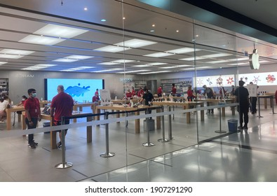 Sydney, NSW  Australia - January 4 2021: The Apple Store, in Broadway Shopping Centre, people in the store are wearing masks.