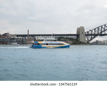 Sydney NSW Australia - March 15th 2019 - Whale Watching Sydney Net and Harbour Bridge Background