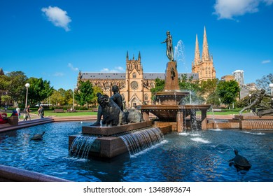 Sydney, NSW, Australia - March 20, 2019: View of the Archibald Fountain and  St Mary's Cathedral in Sandringhan Garden Sydney NSW Australia