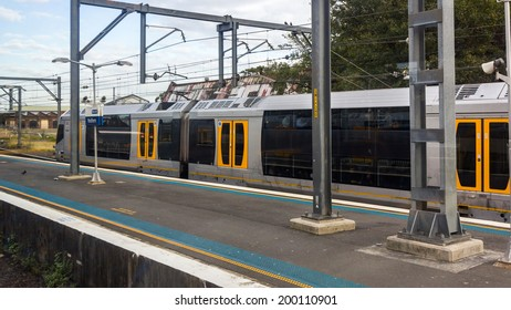 SYDNEY, NSW, AUSTRALIA - May 30, 2014: Sydney Retfern railway station Area at Sunset. Sydney Trains operates quick, frequent and reliable trains in the greater Sydney suburban area.