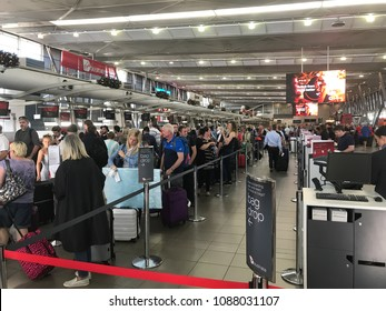 SYDNEY, NSW, AUSTRALIA - NOVEMBER 15, 2017: Passengers queue to check in at Sydney Kingsford Smith Airport
