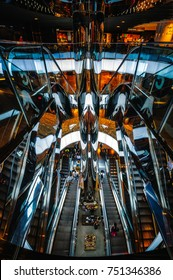Sydney, NSW, AUSTRALIA - November 2, 2017: Dynamic and futuristic interior of the Westfield City Mall with escalators and twisted curved parapets of glass or mirror finish and light panels in Sydney.