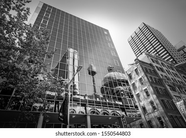 Sydney, NSW, Australia - October 21, 2019: Iconic reflections in black and white of some of the most iconic landmarks including Queen Victoria Building and the City Tower Eye in Sydney, Australia.