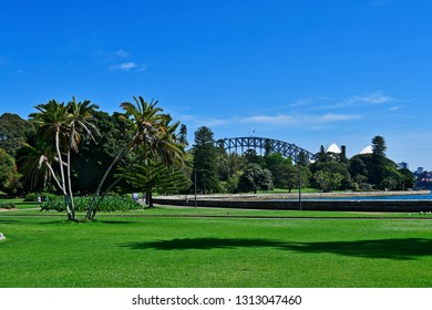 SYDNEY, NSW, AUSTRALIA - OCTOBER 28, 2017: unidentified sporty people in Royal Botanic Garden on Farm cove with Opera and Harbour bridge in background
