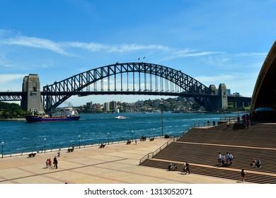 SYDNEY, NSW, AUSTRALIA - OCTOBER 28, 2017: Unidentified people on Circular Quay with historic Harbour Bridge