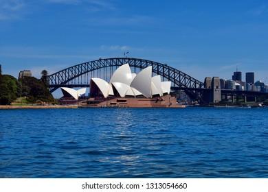 SYDNEY, NSW, AUSTRALIA - OCTOBER 28, 2017:  impressive Sydney Opera and historic Harbour Bridge, landmarks in the capital of New South Wales