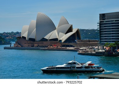 SYDNEY, NSW, AUSTRALIA - OCTOBER  28: Impressive Sydney Opera building and ferry on Circular quay, preferred travel destination and tourist attraction, on October 28, 2017 in Sydney, Australia