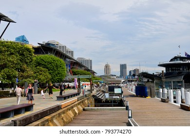 SYDNEY, NSW, AUSTRALIA - OCTOBER 28: Unidentified people and different buildings in Darling Harbor, preferred promenade with cafe's and restaurants, on October 28, 2017 in Sydney, Australia